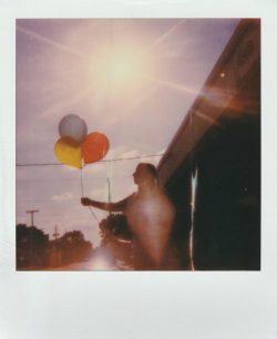Authentic snap in instax instant look. Girl holding baloon.